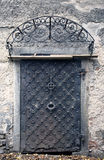 Big metallic old door. Historical house door, one timber leaf, closed black gateway. Stock Images