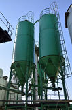 Green silos from cement factory Stock Photo