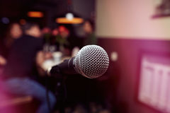 The big microphone in the karaoke bar. The big microphone in the karaoke bar on the background of visitors stock photography