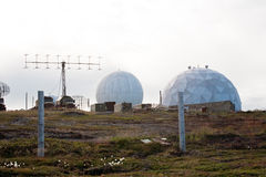Big military antennas. Big military sphere antennas and aerials on outdoor background Stock Photos