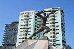 Big Military Monument in Durres. DURRES, ALBANIA - August, 2015: Military monument from the socialist times rises in the sea park. Big residential building Royalty Free Stock Image