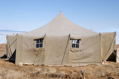 Big military tent. Large army canvas set at winter Baikal stock image