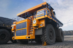 Big mining truck. A picture of a big yellow mining truck at worksite Royalty Free Stock Photos