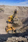 Big mining truck and excavator. A picture of a big yellow mining truck at worksite Stock Images
