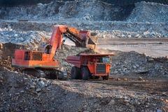 Big mining truck unload coal Stock Images