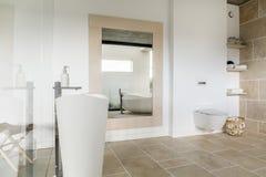 Big mirror in modern bathroom royalty free stock photo