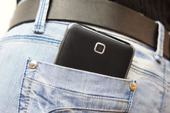 Big mobile phone in woman jeans pocket Royalty Free Stock Images