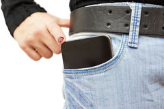 Big mobile phone in woman jeans pocket Stock Photos