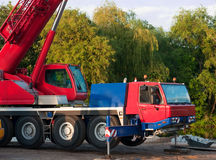 Big mobile truck crane. Big mobile red and blue truck crane Stock Image