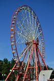 Big and modern multicolour ferris wheel on clean blue sky backgroun. D Royalty Free Stock Image