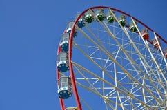 Big and modern multicolour ferris wheel on clean blue sky backgroun. D Stock Image
