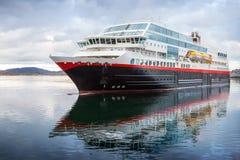 Big modern passenger cruise ship. Sails in Norwegian sea fjord stock photos