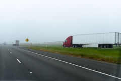Big modern red semi truck trailer going on exit multi lines high Stock Photography