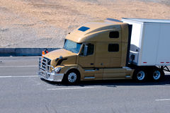 Big modern semi truck with trailer and grille protection Stock Photos