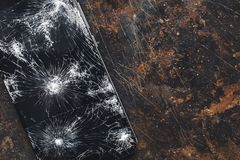 Big modern smartphone with broken screen debris stock photography