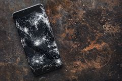 Big modern smartphone with broken screen debris stock photo