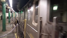 Big modern urban steel silver underground subway train car leaving tube metro station on rails moving fast in 4k shot stock video footage