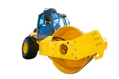 Big modern yellow road roller heavy construction machine isolate Royalty Free Stock Images