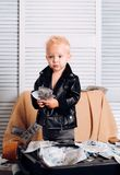 Big money. Little entrepreneur work in office. Small child do business accounting in startup company. Boy child with. Money case. Little boy count money in cash stock photo