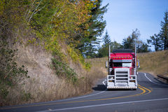 Big monster red rig semi truck with aluminum protection grille Royalty Free Stock Photos