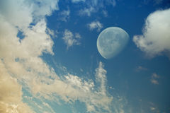 Big moon in evening sky Stock Photography