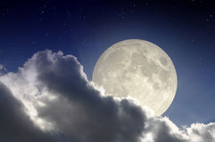 Big moon in the night. Moon over stormy clouds and stars at night Stock Photography