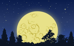 Big moon rising. Big yellow moon rising above dark forest in starry night Royalty Free Stock Images