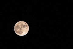 Big moon surrounded by bright stars. Royalty Free Stock Images