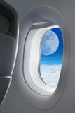 Big moon view outside window plane. Fly me to the moon Stock Image