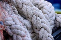 Big mooring ropes. Large mooring ropes folded on the quay in the fishing port of Ajaccio. Corsica. France stock image