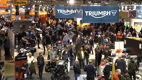 Big motorcycle exhibition. A lot of people at the show bikes.
