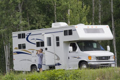 Big Motorhome with owner in the woods Stock Photography