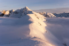 Big mountain peaks at sunset and inversion. Tatry. Poland Royalty Free Stock Photo