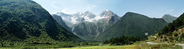 Big mountain valley. North Caucasus mountain peaks walley on a daylight with three waterfalls far away stock image