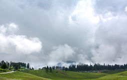 Big mountain White cloud cover,Green forest. Kashmir ,Indian Stock Photography