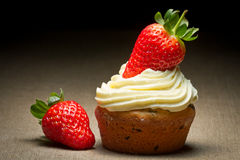Big muffin with strawberrys and sweet cream Royalty Free Stock Images
