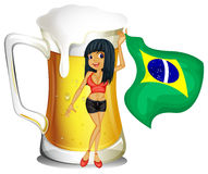 A big mug of beer with a brazilian lady Stock Photography