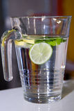 Big mug of fresh water with lemon Stock Images