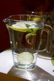 Big mug of fresh water with lemon Stock Photos