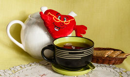 Big mug with tea Stock Images