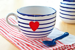 Big mug with tea Stock Images