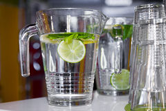 Big mugs of fresh water with lemon Royalty Free Stock Photography