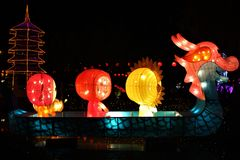 Big  multicolour paper lanterns  floating on water at night. Big  multicolour paper lanterns floating on water Fo Guang Shan Dong Zen Temple, Jenjarom, Banting royalty free stock photos