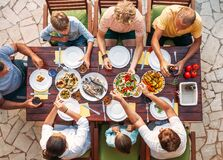 Free Big Multigenerational Family Dinner In Process. Top View Image On Table With Food And Hands. Food Consumption And Royalty Free Stock Photo - 176387325