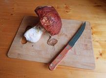 Big mushroom on cutting board with knife. Stock Image