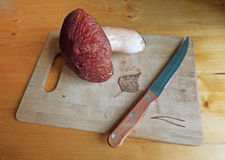 Big mushroom on cutting board with knife Royalty Free Stock Photography