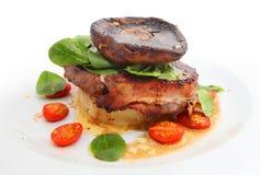 Big mushroom on the steak Royalty Free Stock Image