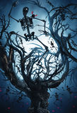 Big mystic tree with halloween skeletons. At night in moon light Royalty Free Stock Images