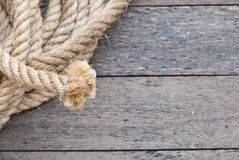 Big navy rope on wooden plank Royalty Free Stock Photo