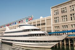 Big neutral yacht moored on the city`s waterfront side area of the town of Boston USA Massachusetts stock images